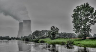 a nuclear power plant in a green landscape