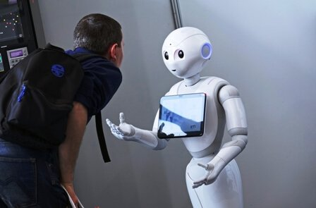 human interacting with robot